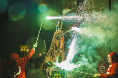 Devils dance Group on Firerun performance. EL VENDRELL, SPAIN - JUL 26: Ball de Diables (Devils dance) Group on Correfoc (Firerun) performance within the Festa Royalty Free Stock Image