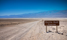 Devils Golf Course Sign. Sing on the road to Devil`s Golf Course, Death Valley National Park, California Royalty Free Stock Photo
