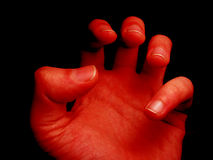 Devils hand. Devils red hand Royalty Free Stock Photo