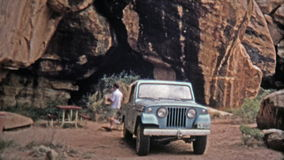1971: Devils Kitchen campsite proves to be a scenic place for lunch for a Jeep driver. stock footage