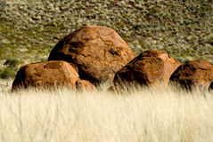 Devils Marbles. Boulders formations rising from the grass in Devils Marbles conservation reserve Stock Image