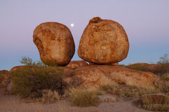 Devils Marbles And Moon Stock Images