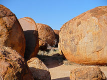 Devils Marbles. The Devils Marbles are a collection of huge round boulders found in the Tennant Creek region of Australia's Northern Territory Stock Images