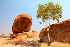 Devils marbles outback Australia granite boulders. Granite eroded rock formation, big stone pebbles geology by erosion Devils Marbles Northern Territory Royalty Free Stock Photography
