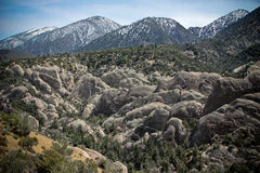 Devils Punchbowl California. Scenic view of Devils punchbowl rock formations with San Gabriel mountains in background, California, U.S.A Stock Photography
