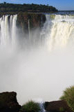 Devils throat, Igausy falls with rainbow close-up. View of the Devils throat, part of Iguassu Falls, the the largest series of waterfalls on the planet, located Stock Image
