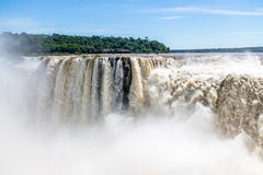 The Devils Throat at Iguazu Falls view from argentinian side - Brazil and Argentina Border. The Devils Throat at Iguazu Falls view from argentinian side in Royalty Free Stock Image