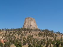 Devils Tower rock formation. Scenic view of Devils Tower rock formation with blue sky background, Wyoming, U.S.A Royalty Free Stock Images