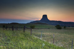 Devils Tower at Sunset. The sun sets behind Devils Tower, Wyoming Stock Image