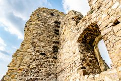 Devin Castle Slovakia 11. Devin Castle Low Angle View of Ruined Fortified Wall with Window and Blue Cloudy Sky at Background stock photography