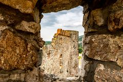 Devin Castle Slovakia 15. Devin Castle Window View of Ruined Fortified Wall and Breathtaking Picturesque Blue Cloudy Sky at Background stock photos