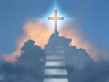 Devine. Cross radiates supernatural energy in clouds Royalty Free Stock Image