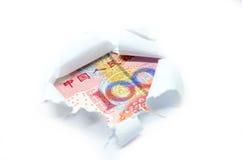 Devise de la Chine par le livre blanc déchiré image stock