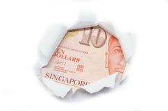 Devise de Singapour jetant un coup d'oeil par le livre blanc photo libre de droits