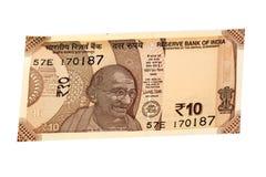Devise indienne 10 roupies sur un backround blanc Photographie stock libre de droits