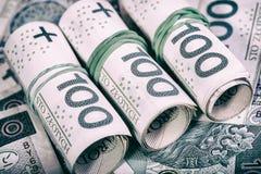 Devise polonaise PLN, argent Classez le rouleau de billets de banque de 100 PLN et x28 ; P Images stock