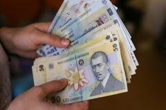 devise roumaine de 50 et de 100 Lei images stock