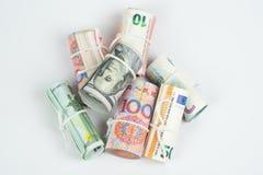 Devises et concepts marchands d'échange d'argent Les rouleaux de dif Photographie stock libre de droits