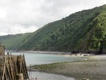 Devon Bay. A coastal bay in Devon, England with old ladders and steps on the harbour wall Royalty Free Stock Image