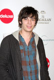 Devon Bostick. LOS ANGELES - DEC 7:  Devon Bostick arrives at the Junior Hollywood Radio and Television Society 8th Annual Young Hollywood Holiday Party at Royalty Free Stock Photo
