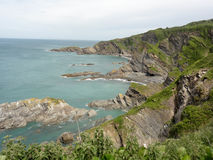 Devon Cliffs. A scenic view of coastal cliffs and rocks in Devon, UK Stock Photo
