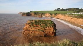 Devon Coast Ladram Bay with sandstone rock stack stock footage