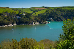 Devon coastline near Dartmouth, Devon. Where the Dart estuary meets the sea near Dartmouth town on the River Dart. England.Photo taken from the South-West Royalty Free Stock Photos