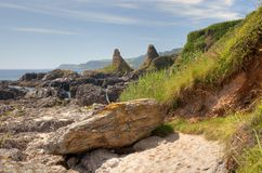 Devon Coastline in summer. Interesting rock formations at Great Mattiscombe Sand, Devon, England stock photography