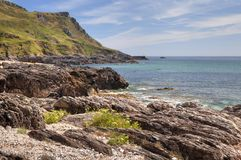Devon Coastline in summer. The rugged coastline at Great Mattiscombe Sand, Devon, England royalty free stock photography