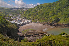 A Devon Cove. Hele, a seaside cove and houses on the outskirts of Ilfracombe in Devon, England Royalty Free Stock Photo