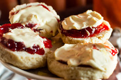 Devon Cream Tea. Scones with Jam and Clotted Cream, Shallow Depth of Field Close up horizontal photography Stock Image