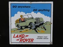 Devon, England - August 17 2018. An old metal Land Rover advert, retro, found at an old steam railway. stock photos