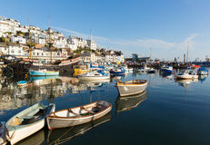 Devon harbour of Brixham England during the heatwave of Summer 2013. Brixham marina harbour Devon England with boats on a calm day with blue sky during the Stock Photo