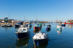 Devon harbour of Brixham England during the heatwave of Summer 2013. Brixham marina harbour Devon England with boats on a calm day with blue sky during the Royalty Free Stock Images