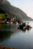 Devon Morning. The sun soaks up the early morning mist at Seaton harbour, Devon, England Stock Photo
