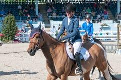 DEVON, PA - 25 MEI: Ruiters die met hun paarden in Devon Horse Show op 25 Mei, 2014 presteren Royalty-vrije Stock Afbeelding