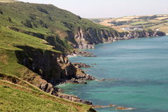 Devon Rocky Coast. Taken at Start Point in Devon near Kingsbridge, England, UK. Shows the fields coming down to the North Hallsands Beach and the cliffs around Stock Photography