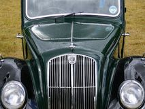 Devon, UK - July 28 2018: A green and black Morris 8, front view of the grill and bonnet and lights stock photography