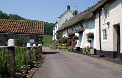 Devon village. A row of whitewashed thatched cottages in a Devon village Royalty Free Stock Images