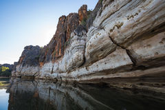 Devonian limestone cliffs of Geikie Gorge. Stunning Devonian limestone cliffs of Geikie Gorge where the Fitzroy River carves its way through the Napier Range in royalty free stock photography