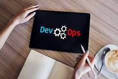 DevOps - development cycles of Automation and monitoring at all steps of software construction. DevOps - development cycles of Automation and monitoring at all royalty free stock images
