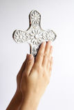 Devote. Hands and cross in a devotion position Royalty Free Stock Photos