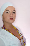 Devote woman. Portrait of a devote woman of  afrocuban religion wearing white clothes and mystic collar Royalty Free Stock Photography