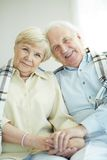 Devoted couple. Portrait of cheerful senior couple looking at camera with smiles Stock Image