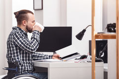 Devoted disabled gentleman working at home Royalty Free Stock Photography