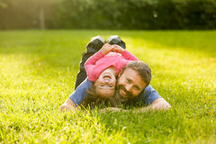 Devoted father and daughter lying on grass Royalty Free Stock Images