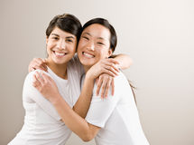 Devoted friends hugging. Happy, devoted friends are hugging Stock Image