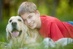 Devoted friends. Portrait of happy lad with his friendly pet looking at camera Stock Photography
