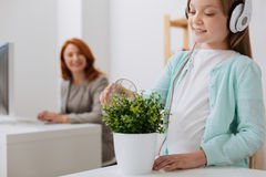 Devoted pretty girl nurturing the plant Stock Images