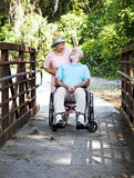Devoted Senior Couple. Devoted senior wife cares for her disabled husband Royalty Free Stock Images